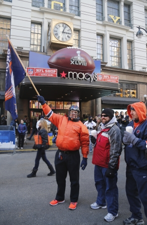 30 s: NEW YORK - JANUARY 30  Unidentified Denver Broncos fans in the front of Macy s Herald Square on Broadway during Super Bowl XLVIII week in Manhattan on January 30, 2014