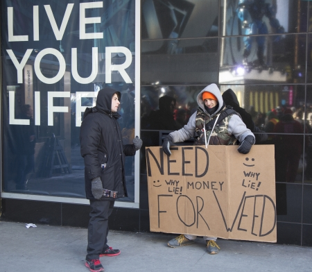 super bowl: NEW YORK - JANUARY 30 Unidentified man with sign asking for money to buy weed on Broadway during Super Bowl XLVIII week in Manhattan on January 30, 2014