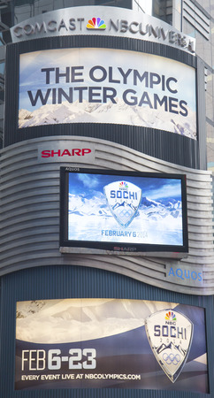 NEW YORK - JANUARY 26  Comcast NBC Universal billboard decorated with Sochi 2014 XXII Olympic Winter Games logo near Times Square in Midtown Manhattan on January 26, 2014