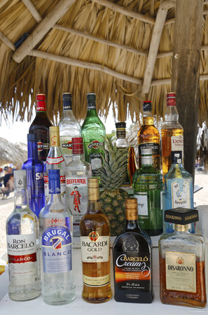 bacardi: PUNTA CANA, DOMINICAN REPUBLIC - DECEMBER 31 Local and International drinks at the beach bar at the Now Larimar All-inclusive Hotel  in Punta Cana on December 31, 2013