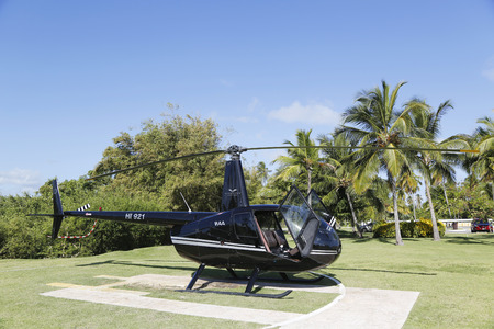 PUNTA CANA, DOMINICAN REPUBLIC - DECEMBER 31 The Robinson R44 Helicopter from Cana Fly in Punta Cana on December 31, 2013 The Robinson R44 is a four-seat light utility and trainer helicopter