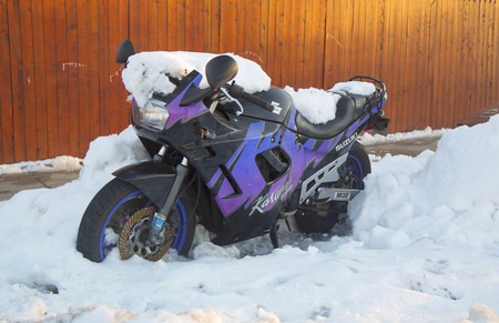 BROOKLYN, NEW YORK - FEBRUARY 6  Suzuki motorcycle under snow on February 6, 2014 in Brooklyn, NY after massive winter storms strikes Northeast