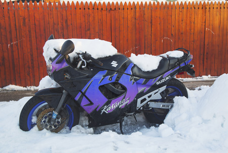 suzuki: BROOKLYN, NEW YORK - FEBRUARY 6  Suzuki motorcycle under snow on February 6, 2014 in Brooklyn, NY after massive winter storms strikes Northeast