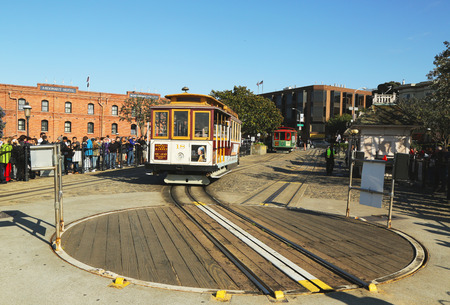 permanently: SAN FRANCISCO -MARCH 28  Cable car on turntable at Hyde and Beach terminal on March 28, 2013 in San Francisco The San Francisco cable car is world last permanently manually operated cable car system Editorial