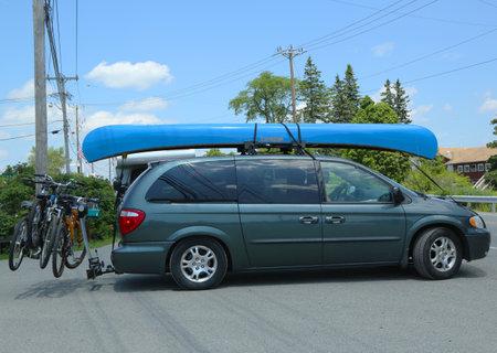 BAR HARBOR, MAINE - JULY 5  Dodge Caravan Van loaded with kayak and bicycles in Acadia National Park on July 5, 2013  Acadia National Park reserves much of Mount Desert Island in Maine