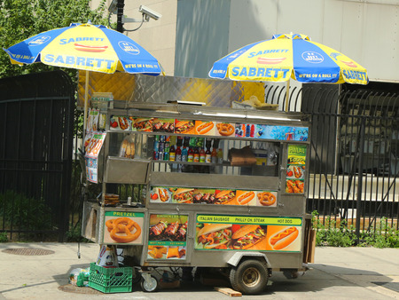 NEW YORK - AUGUST 6 Street vendor cart in Manhattan on August 6, 2013  There are about 4,000 mobile food vendors licensed by the city