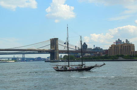 topsail: NEW YORK - AUGUST 17  Clipper City Tall Ship next to Brooklyn Bridge on August 17, 2013  Topsail schooner Clipper City is the  New York�s largest sailing vessel can accommodate up to 134 passengers