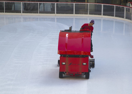 resurfacing: NEW YORK - MARCH 20  Ice resurfacing at the Ice  Rink at Rockefeller Center in midtown Manhattan on March 20, 2014  An ice resurfacer is a vehicle used to clean and smooth the surface of an ice rink