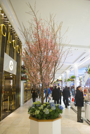herald: NEW YORK - APRIL 1  The Secret Garden theme flower decoration with Cherry tree during famous Macy s Annual Flower Show in the department store at the Herald Square in  Manhattan on April 1, 2014