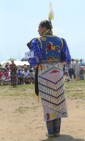 pow wow: BROOKLYN, NEW YORK -JUNE 2 Unidentified female Native American dancer wears traditional Pow Wow dress during the NYC Pow Wow in Brooklyn on June 2, 2013  Editorial