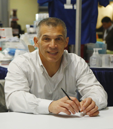NEW YORK CITY - DECEMBER 1 New York Yankees General Manager Joe Girardi during autographs session in New York on December 1, 2013