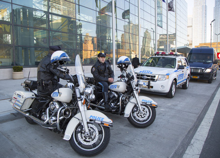 new world order: NEW YORK - APRIL 24  NYPD highway patrol officers on motorcycles providing security in Manhattan on April 24, 2014  New York Police Department, established in 1845, is the largest police force in USA