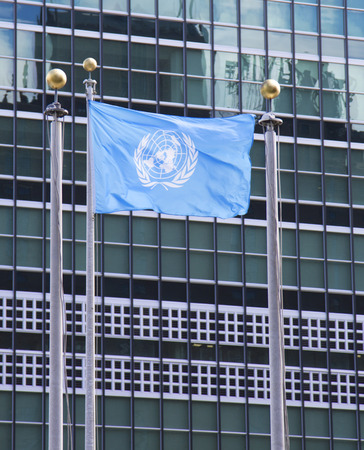 un:  United Nations Flag in the front of UN Headquarter in New York