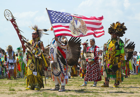 BROOKLYN, NEW YORK - JUNE 2  The Eagle Staff leads the Grand Entry at he NYC Pow Wow in Brooklyn on June 2, 2013  A pow-wow is a gathering and Heritage Celebration of North America s Native people