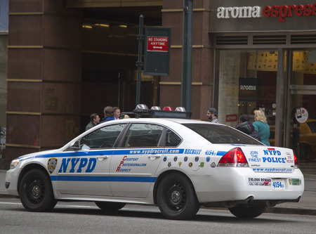 new world order: NEW YORK - March 20  NYPD recruit car in midtown Manhattan on March 20, 2014  New York Police Department, established in 1845, is the largest police force in USA
