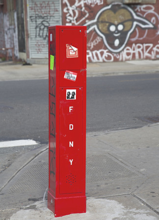 BROOKLYN, NEW YORK - MAY 1  FDNY Emergency Reporting System box to notify the police and fire department on May1, 2014 in Brooklyn, New York