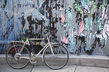 Old bicycle parked and locked in Brooklyn, New York