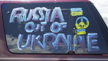 seized: NEW YORK - APRIL 27  Sign at the Ukraine supporter car in Brooklyn on April 27, 2014  2014 Ukrainian revolution continued with the 2014 Crimean crisis when Russian forces seized control of the Crimea  Editorial