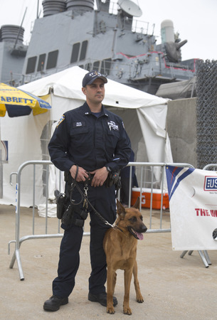 counter terrorism: NEW YORK - MAY 22  NYPD counter terrorism officer with Belgian shepherd providing security during Fleet Week 2014 on May 22, 2014 in New York