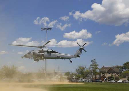 countermeasures: FREEPORT, NEW YORK - MAY 25  MH-60S helicopter from Helicopter Sea Combat Squadron Five with US Navy EOD team taking off after mine countermeasures demonstration during Fleet Week 2014 in Long Island on May 25, 2014