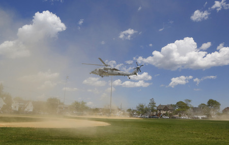 freeport: FREEPORT, NEW YORK - MAY 25  MH-60S helicopter from Helicopter Sea Combat Squadron Five with US Navy EOD team taking off after mine countermeasures demonstration during Fleet Week 2014 in Long Island on May 25, 2014