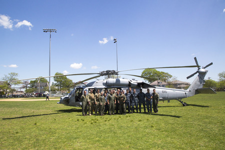 freeport: FREEPORT, NEW YORK - MAY 25  Helicopter Sea Combat Squadron Five with US Navy EOD team in the front of  MH-60S during Fleet Week 2014 on May 25, 2014 Editorial