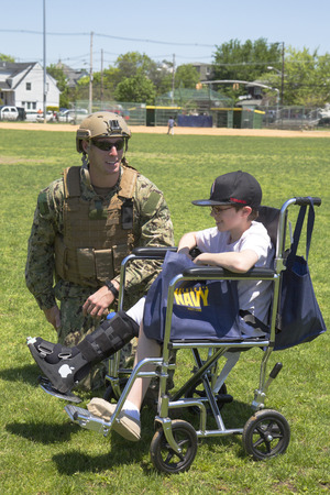 countermeasures: FREEPORT, NEW YORK - MAY 25 Unidentified US Navy from EOD team with unidentified child after mine countermeasures demonstration during Fleet Week 2014 in Long Island on May 25, 2014 Editorial