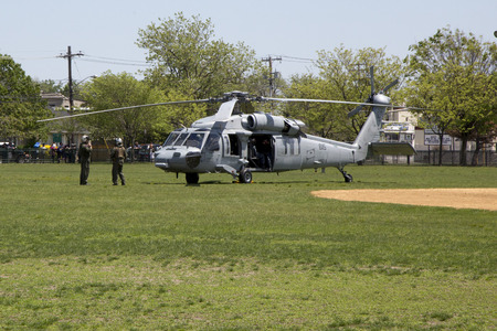 countermeasures: FREEPORT, NEW YORK - MAY 25  MH-60S helicopter from Helicopter Sea Combat Squadron Five with US Navy EOD team taking off after mine countermeasures demonstration during Fleet Week 2014 on May 25, 2014