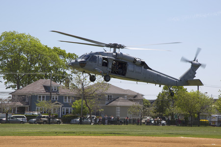 countermeasures: FREEPORT, NEW YORK - MAY 25  MH-60S helicopters from Helicopter Sea Combat Squadron Five with US Navy EOD team landing for mine countermeasures demonstration during Fleet Week 2014 on May 25, 2014