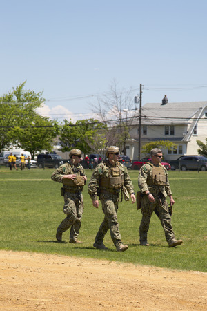 countermeasures: FREEPORT, NEW YORK - MAY 25 Unidentified US Navy s from EOD team after mine countermeasures demonstration during Fleet Week 2014 in Long Island on May 25, 2014