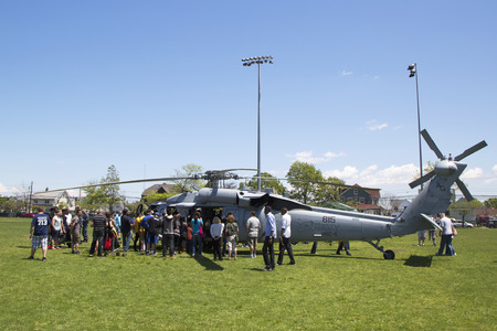 countermeasures: Numerous spectators around MH-60S helicopter from Helicopter Sea Combat Squadron Five during Fleet Week 2014