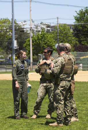 countermeasures: FREEPORT, NEW YORK - MAY 25 Unidentified US Navy s from EOD team and unidentified helicopter pilot after mine countermeasures demonstration during Fleet Week 2014 in Long Island on May 25, 2014