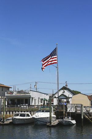 freeport: FREEPORT, NEW YORK - MAY 29  American flag flying in Freeport, Long Island on May 29, 2014 Editorial