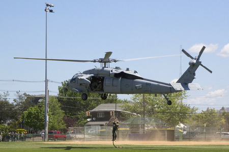 countermeasures: FREEPORT, NEW YORK - MAY 25 MH-60S helicopter from Helicopter Sea Combat Squadron Five with US Navy EOD team landing for mine countermeasures demonstration during Fleet Week 2014 on May 25, 2014