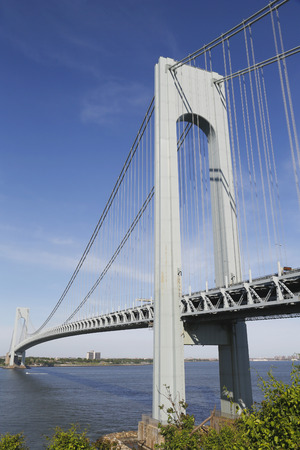 boroughs: NEW YORK  - JUNE 1  Verrazano Bridge in New York on June 1, 2014  The Verrazano Bridge is a double-decked suspension bridge that connects the boroughs of Staten Island and Brooklyn in New York City