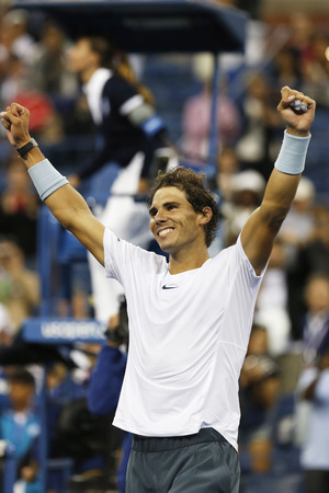 NEW YORK - SEPTEMBER 7  Twelve times Grand Slam champion Rafael Nadal celebrates victory after semifinal match at US Open 2013 against Richard Gasquet at Arthur Ashe Stadium on September 7, 2013 in Flushing, NY 新闻类图片