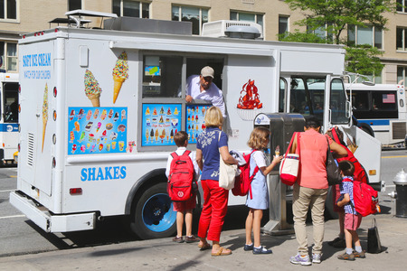 NEW YORK - JUNE 5  Ice cream truck in midtown Manhattan on June 5, 2014  Mister Softee is a United States-based ice cream truck franchisor popular in the Northeast founded in 1956