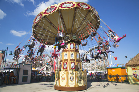 BROOKLYN, NEW YORK - MAY 17  Lynn s Trapeze swing carousel on May 17, 2014 in Coney Island Luna Park  Coney Island Luna Park was destroyed by fire in 1944, then reopened in 2010 Stock Photo - 28979185
