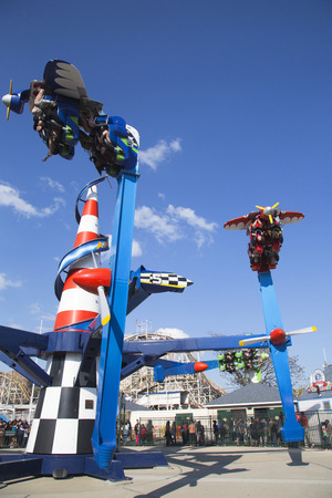 BROOKLYN, NY - MAY 17  Air race on May 17, 2104 in Coney Island Luna Park Riders pilot their own planes around a  control tower  in this spinning ride  Air Race made its world debut at Luna Park  Stock Photo - 28979190