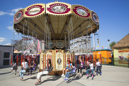 BROOKLYN, NEW YORK - MAY 17  Lynn s Trapeze swing carousel on May 17, 2014 in Coney Island Luna Park  Coney Island Luna Park was destroyed by fire in 1944, then reopened in 2010  Stock Photo - 28979197