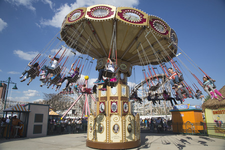 BROOKLYN, NEW YORK - MAY 17  Lynn s Trapeze swing carousel on May 17, 2014 in Coney Island Luna Park  Coney Island Luna Park was destroyed by fire in 1944, then reopened in 2010 Stock Photo - 29137829