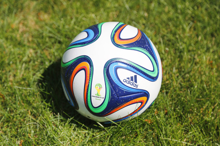 adidas: NEW YORK - JUNE 22  Brazuca ball on grass in New York on June 22, 2014  The Adidas Brazuca is the official match ball of the 2014 FIFA World Cup, which is being held in Brazil