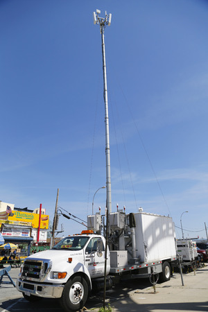 cell tower: BROOKLYN, NY- JUNE 15  Verizon Wireless mobile cell tower at Coney Island on June 15, 2014  Verizon is a large American broadband and telecommunications company with 110 9 billion USD in revenue