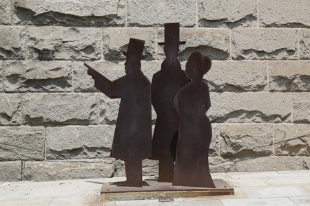 chiefly: BROOKLYN, NY - JUNE 17  Statues of John Roebling, his son Washington and Washington�s wife Emily who were chiefly responsible for the design and construction of the Brooklyn Bridge on June 17, 2014