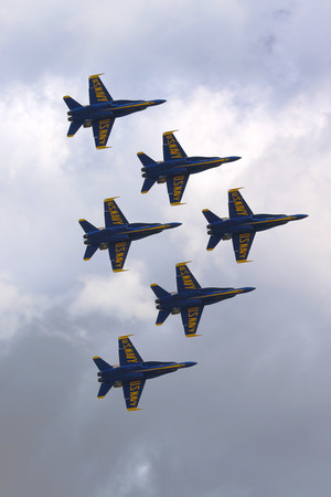 f18: JONES BEACH, NY MAY 25  US Navy Blue Angels F-18 Hornet planes perform in air show during Fleet Week 2014 in Jones Beach on May 25, 2014  Blue Angels are the oldest active aerobatic team in the world