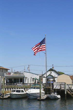 freeport: FREEPORT, NEW YORK - MAY 29  American flag flying in Freeport, Long Island on May 29, 2014