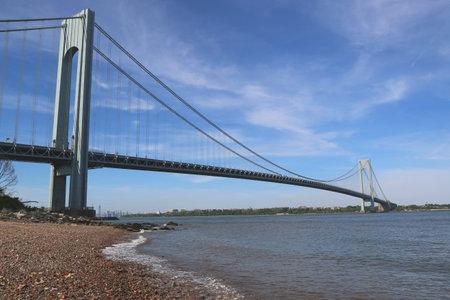 boroughs: NEW YORK CITY - JUNE 1  Verrazano Bridge in New York on June 1, 2014  The Verrazano Bridge is a double-decked suspension bridge that connects the boroughs of Staten Island and Brooklyn