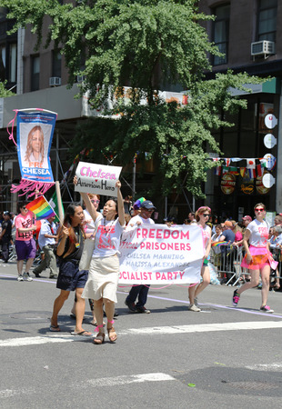 amnesty: NEW YORK - June 29, 2014  Amnesty International group demanding freedom for Chelsea Manning  born Bradley Manning  during  LGBT Pride Parade  in New York City on June 29, 2014   Editorial