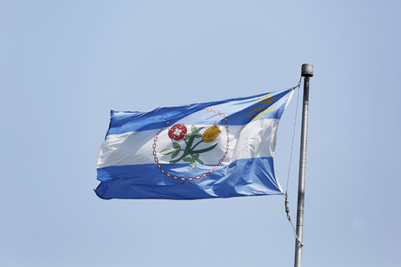 boroughs: NEW YORK - JULY 8 The Borough of Queens official flag in New York on July 8, 2014  Queens is the easternmost and largest in area of the five boroughs of New York City