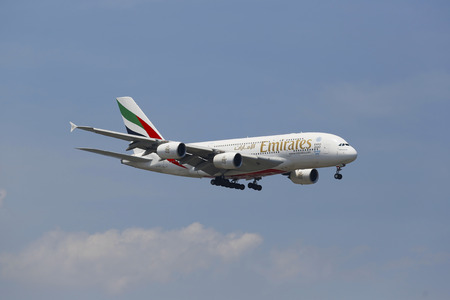 world's: NEW YORK -JULY 8  Emirates Airline Airbus A380 in New York sky before landing at JFK Airport on July 8, 2014  The Airbus A380 is a double-deck, wide-body, world s largest passenger airliner